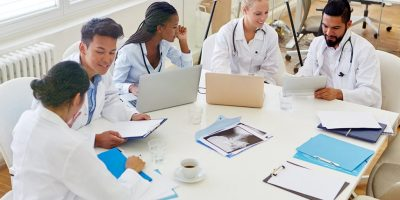 Healthcare professionals working around a table.